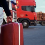 Spouse holding a red suitcase- Raleigh Divorce Lawyer