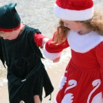 Two kids holding hands on a beach - raleigh Child Custody Lawyers