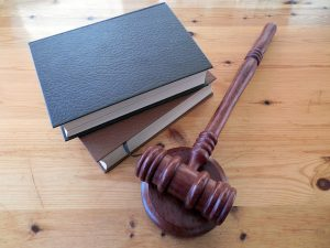 divorce at 50 - judges gavel and books on wooden table