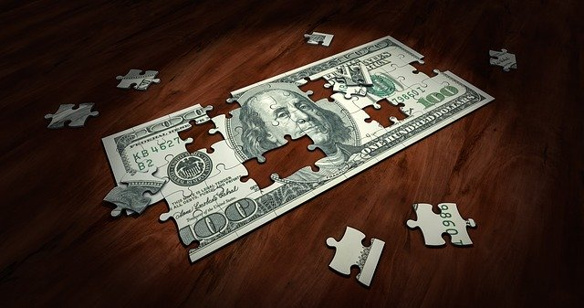 One hundred dollar bill made of puzzle pieces - Can You Lower Your Alimony as a Result of the Coronavirus?