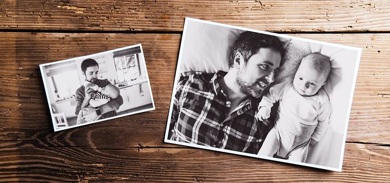 Black and white pictures of a dad with his baby