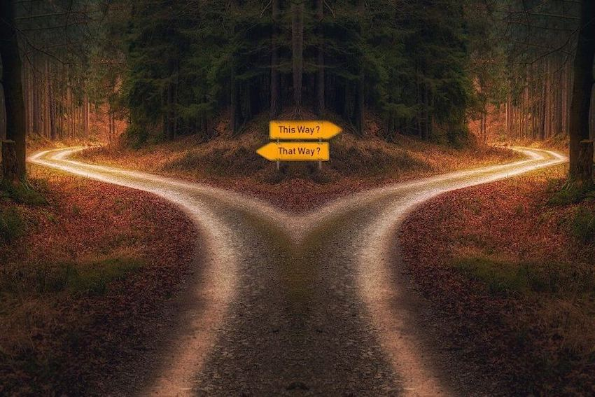 Signs pointing in different directions at a fork in the road when deciding when to file your separation papers