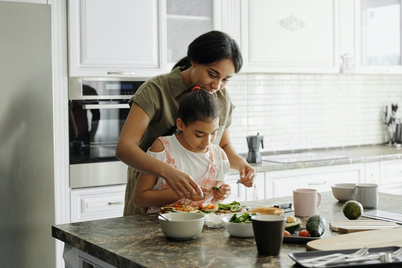 Mother with 50 50 joint custody cooking with daughter in Raleigh