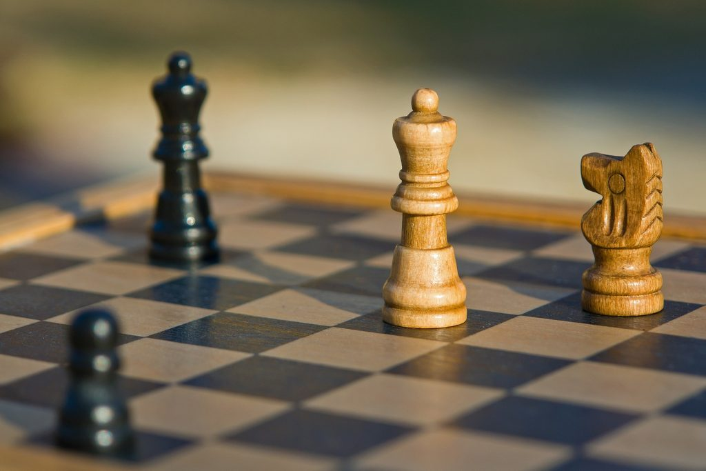 Divorce negotiation tactics represented by a chess board with 2 pieces of each color